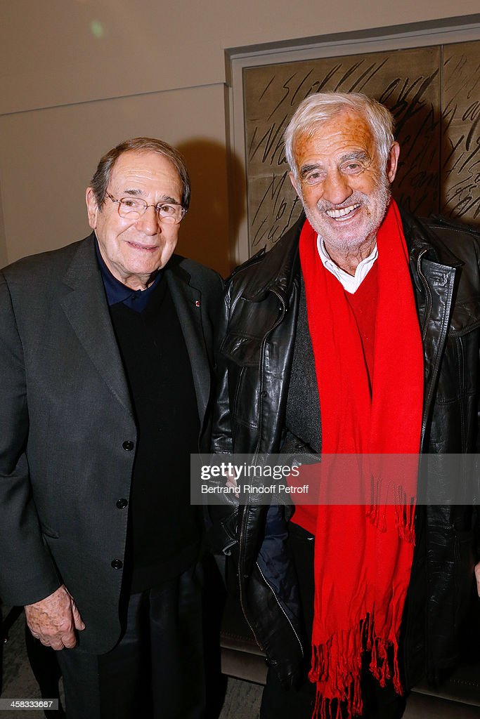 Director Robert Hossein and actor Jean-Paul Belmondo pose backstage following the show of impersonator Laurent Gerra 'Un spectacle Normal' at L'Olympia on December 20, 2013 in Paris, France.