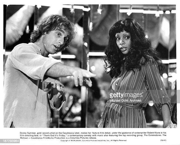 Director Robert Klane instructs actress Donna Summer on the set of the Columbia Pictures movie ' Thank God It's Friday' in 1978