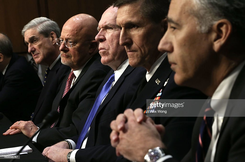 FBI Director Robert Mueller, Director of National Intelligence James Clapper, CIA Director John Brennan, Defense Intelligence Agency Director Lt. Gen. Michael Flynn, and Assistant Secretary of State for Intelligence and Research Philip Goldberg testify during a hearing before the Senate (Select) Intelligence Committee March 12, 2013 on Capitol Hill in Washington, DC. The committee held a hearing on 'Current and Projected National Security Threats to the United States.'