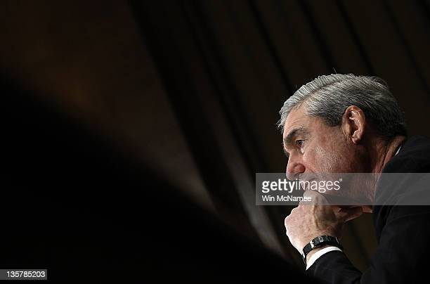 Director Robert Mueller III testifies before the Senate Judiciary Committee during a oversight hearing on Capitol Hill December 14 2011 in Washington...