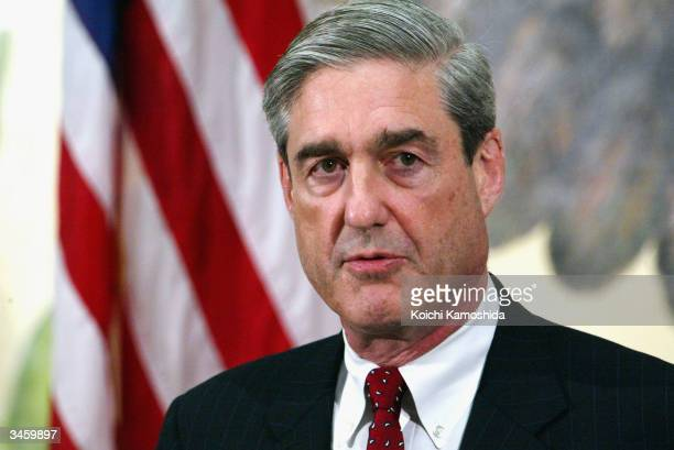 Director Robert Mueller speaks at a press conference at the US Embassy April 23 2004 in Tokyo Mueller is on a three day visit to Japan to discuss...