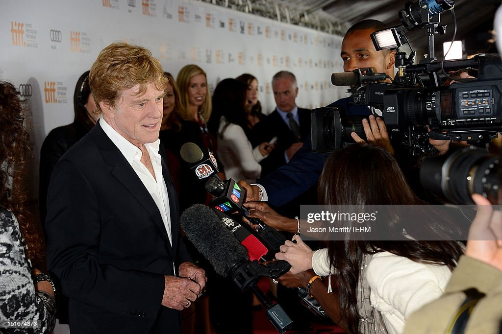 Director <a gi-track='captionPersonalityLinkClicked' href=/galleries/search?phrase=Robert+Redford&family=editorial&specificpeople=202897 ng-click='$event.stopPropagation()'>Robert Redford</a> is interviewed at 'The Company You Keep' Premiere at the 2012 Toronto International Film Festival at Roy Thomson Hall on September 9, 2012 in Toronto, Canada.
