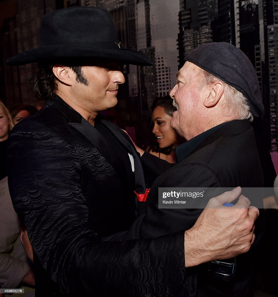 Director Robert Rodriguez (L) and actor <a gi-track='captionPersonalityLinkClicked' href=/galleries/search?phrase=Stacy+Keach&family=editorial&specificpeople=742852 ng-click='$event.stopPropagation()'>Stacy Keach</a> talk at the after party for the premiere of Dimension Films' 'Sin City: A Dame To Kill For' at the Roosevelt Hotel on August 19, 2014 in Los Angeles, California.