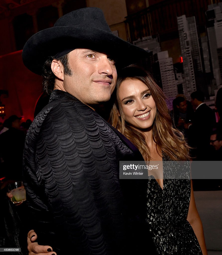Director Robert Rodriguez (L) and actress <a gi-track='captionPersonalityLinkClicked' href=/galleries/search?phrase=Jessica+Alba&family=editorial&specificpeople=201811 ng-click='$event.stopPropagation()'>Jessica Alba</a> pose at the after party for the premiere of Dimension Films' 'Sin City: A Dame To Kill For' at the Roosevelt Hotel on August 19, 2014 in Los Angeles, California.
