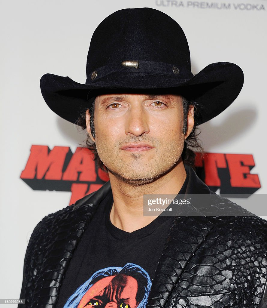 Director <a gi-track='captionPersonalityLinkClicked' href=/galleries/search?phrase=Robert+Rodriguez+-+Film+Director&family=editorial&specificpeople=209350 ng-click='$event.stopPropagation()'>Robert Rodriguez</a> arrives at the Los Angeles Premiere 'Machete Kills' at Regal Cinemas L.A. Live on October 2, 2013 in Los Angeles, California.