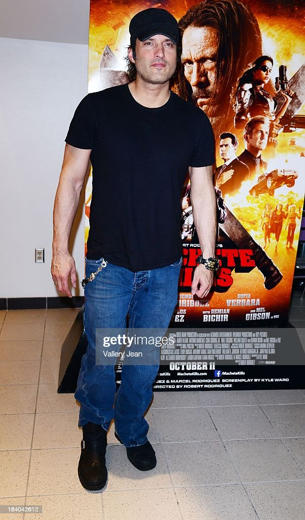 Director Robert Rodriguez attends 'Machete Kills' red carpet premiere at Regal South Beach on October 10, 2013 in Miami, Florida.