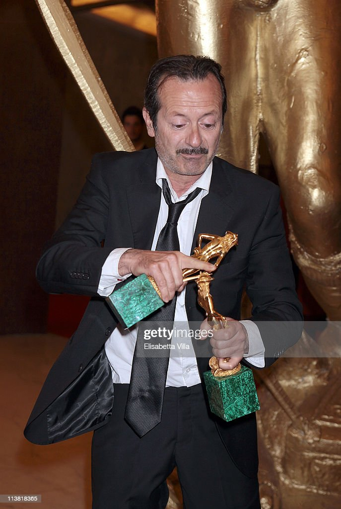 Director Rocco Papaleo shows his award for the Best Debutant Director at the end of 2011 Premi David di Donatello Italian Academy Awards at Auditorium della Conciliazione on May 6, 2011 in Rome, Italy.
