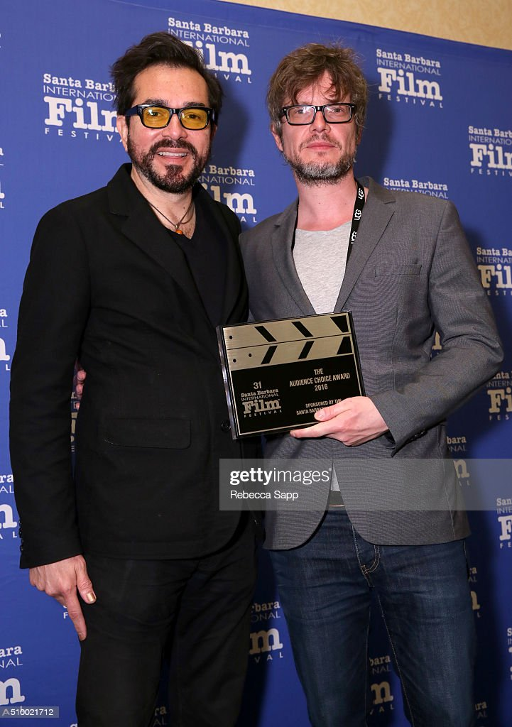 Director <a gi-track='captionPersonalityLinkClicked' href=/galleries/search?phrase=Roger+Durling&family=editorial&specificpeople=217770 ng-click='$event.stopPropagation()'>Roger Durling</a> presents the Audience Choice Award to Director Gerd Schneider of 'The Culpable' at the Awards Breakfast at the Fess Parker during the 31st Santa Barbara International Film Festival on February 13, 2016 in Santa Barbara, California.