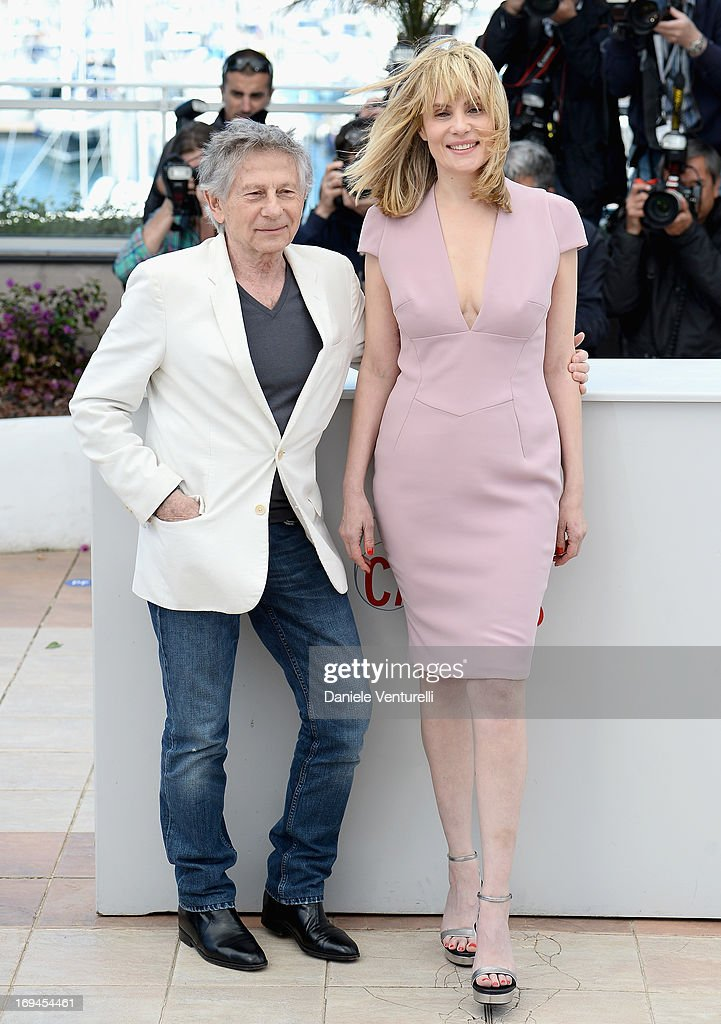 Director Roman Polanski and actress <a gi-track='captionPersonalityLinkClicked' href=/galleries/search?phrase=Emmanuelle+Seigner&family=editorial&specificpeople=240590 ng-click='$event.stopPropagation()'>Emmanuelle Seigner</a> attend the photocall for 'La Venus A La Fourrure' at The 66th Annual Cannes Film Festival at the Palais des Festivals on May 25, 2013 in Cannes, France.