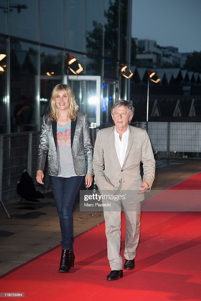 Director Roman Polanski (R) and wife Emmanuelle Seigner attend the 'Blue Jasmine' Paris premiere at UGC Cine Cite Bercy on August 27, 2013 in Paris, France.