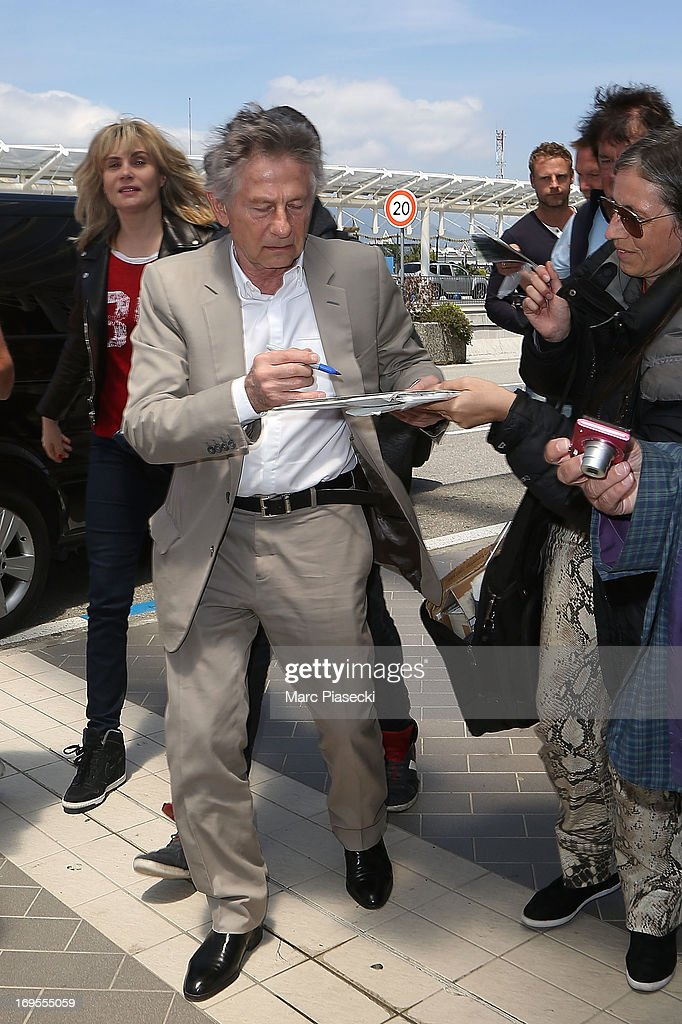 Director Roman Polanski signs autographs as he is sighted at Nice airport after the 66th Annual Cannes Film Festival on May 27, 2013 in Nice, France.
