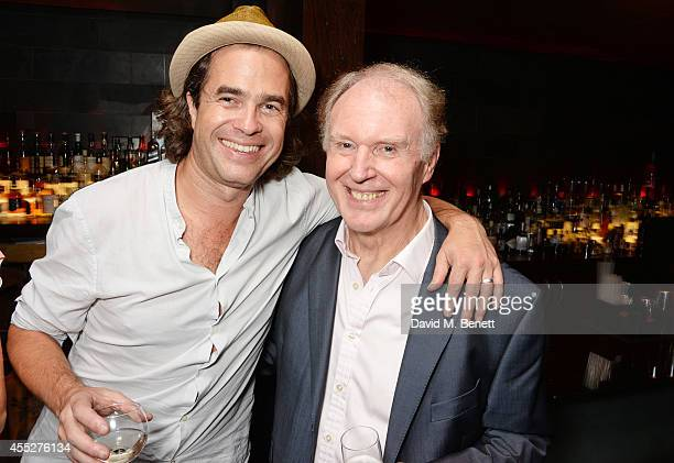 Director Rupert Goold and cast member Tim PigottSmith attend an after party celebrating the press night performance of 'King Charles III' at Mint...