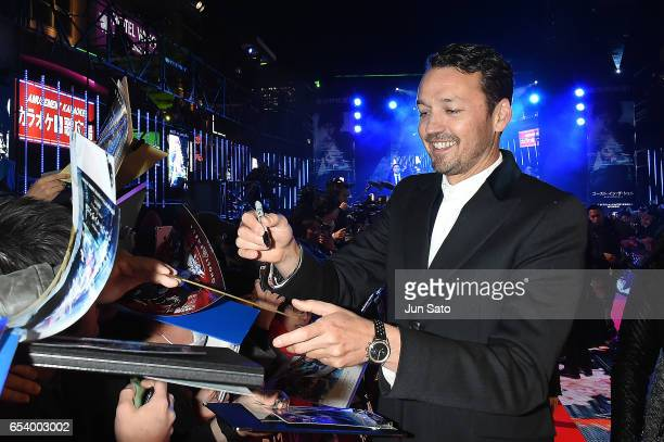 Director Rupert Sanders signs autographs for fans at the World Premiere of the Paramount Pictures release 'Ghost In The Shell' at TOHO Cinemas...