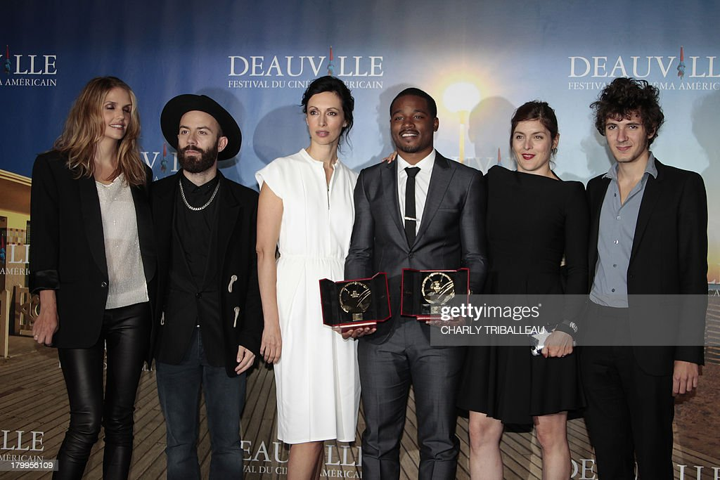 US director Ryan Coogler (3rdR) flanked by the jury poses with the 'Cartier revelation prize' and the 'Deauville audience award' he won with the film 'Fruitvale station' on September 7, 2013 as part of the Deauville US Film Festival, in the French northwestern sea resort of Deauville. AFP PHOTO/CHARLY TRIBALLEAU