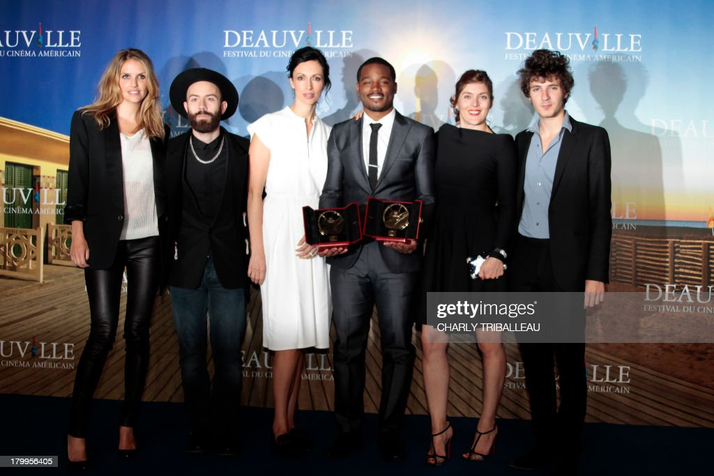 US director Ryan Coogler (3rdR) flanked by the jury poses with the 'Cartier revelation prize' and the 'Deauville audience award' he won with the film 'Fruitvale station' on September 7, 2013 as part of the Deauville US Film Festival, in the French northwestern sea resort of Deauville.