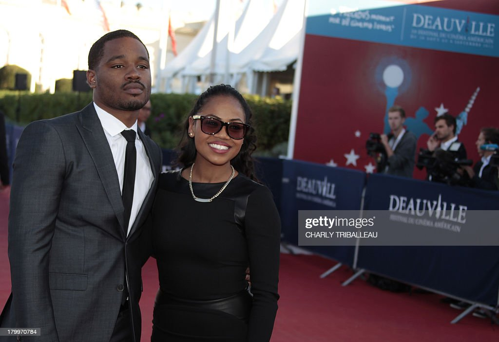 US director Ryan Coogler poses with a guest on the red carpet as he arrives at the awarding ceremony to win the 'Cartier revelation prize' and the 'Deauville audience award' with the film 'Fruitvale station' on September 7, 2013 as part of the Deauville US Film Festival, in the French northwestern sea resort of Deauville.
