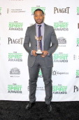 Director Ryan Coogler poses with the Best First Feature Award for 'Fruitvale Station' in the press room during the 2014 Film Independent Spirit...