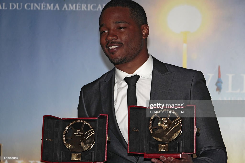 US director Ryan Coogler poses with the 'Cartier revelation prize' and the 'Deauville audience award' he won with the film 'Fruitvale station' on September 7, 2013 as part of the Deauville US Film Festival, in the French northwestern sea resort of Deauville. AFP PHOTO/CHARLY TRIBALLEAU