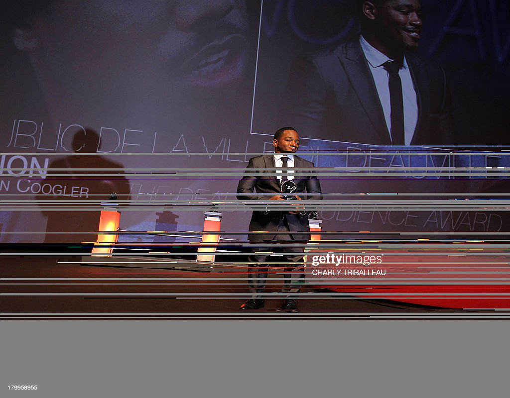 US director Ryan Coogler poses with the 'Cartier revelation prize' and the 'Deauville audience award' he won with the film 'Fruitvale station' on September 7, 2013 as part of the Deauville US Film Festival, in the French northwestern sea resort of Deauville.