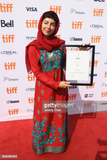 Director Sadaf Foroughi poses after being awarded with the Prize of the International Federation of Film Critics Discovery for 'Ava' at the 2017 TIFF...
