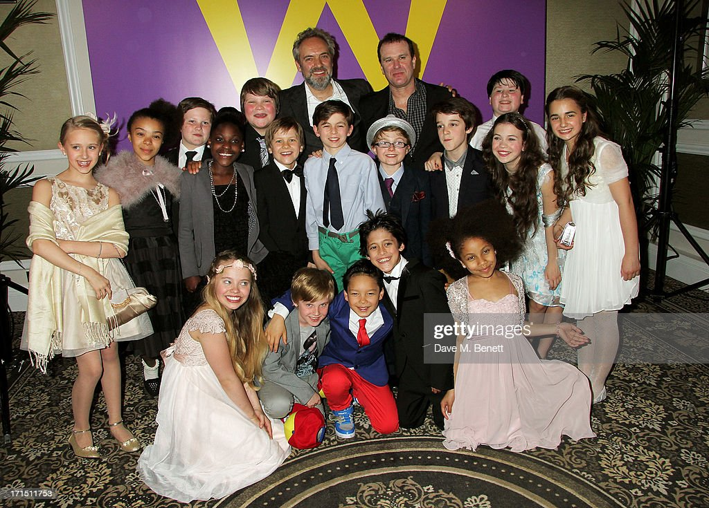 Director <a gi-track='captionPersonalityLinkClicked' href=/galleries/search?phrase=Sam+Mendes&family=editorial&specificpeople=211300 ng-click='$event.stopPropagation()'>Sam Mendes</a> (rear L) and Douglas Hodge (rear R) pose with the young cast at an after party celebrating the press night performance of 'Charlie And The Chocolate Factory' at The Grand Connaught Rooms on June 25, 2013 in London, England.