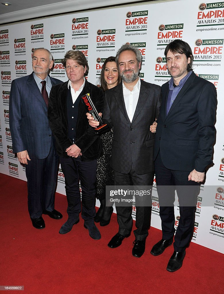 Director Sam Mendes (second right) with the Best Film award for 'Skyfall' with producers Michael G Wilson (L) and Barbara Broccoli (C) and guests at the Jameson Empire Awards at Grosvenor House on March 24, 2013 in London, England. Renowned for being one of the most laid-back awards shows in the British movie calendar, the Jameson Empire Awards celebrate the film industry's success stories of the year with Empire Magazine readers voting for the winners. Visit empireonline.com/awards2013 for more information.