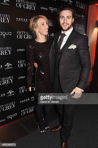 Director Sam TaylorJohnson and Aaron TaylorJohnson attend an after party following the UK Premiere of 'Fifty Shades Of Grey' at aqua London on...