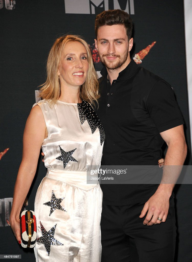 Director Sam Taylor-Wood (L) and actor Aaron Taylor-Johnson pose in the press room at the 2014 MTV Movie Awards at Nokia Theatre L.A. Live on April 13, 2014 in Los Angeles, California.