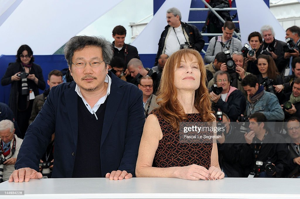 Director Sang-soo Hong and actress <a gi-track='captionPersonalityLinkClicked' href=/galleries/search?phrase=Isabelle+Huppert&family=editorial&specificpeople=662796 ng-click='$event.stopPropagation()'>Isabelle Huppert</a> pose at the 'Da-reun Na-ra-e-suh' photocall during the 65th Annual Cannes Film Festival at Palais des Festivals on May 21, 2012 in Cannes, France.