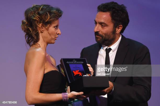 Director Saverio Costanzo receives for actor Adam Driver the Best Actor award for ''Hungry Hearts' and his JaegerLeCoultre engraved Reverso watch on...