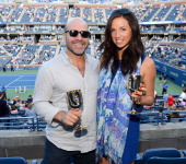 Director Scott Burns and Ashley Porter visit the Moet Chandon Suite at the 2012 US Open at the USTA Billie Jean King National Tennis Center on...