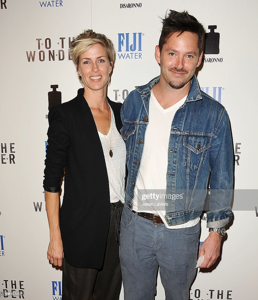 Director Scott Cooper (R) and wife Jocelyne Cooper attend the premiere of 'To The Wonder' at Pacific Design Center on April 9, 2013 in West Hollywood, California.