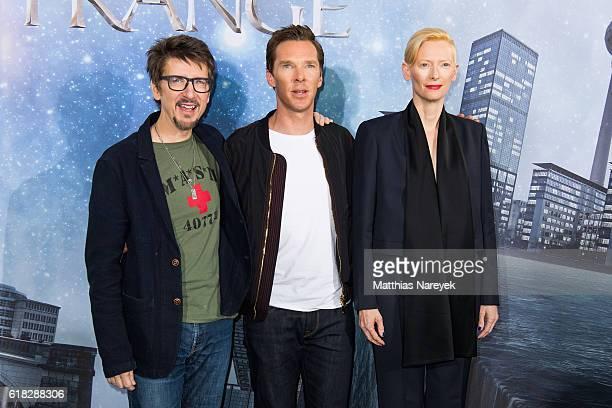 Director Scott Derrickson Benedict Cumberbatch and Tilda Swinton attend the 'Doctor Strange' photocall at Soho House on October 26 2016 in Berlin...