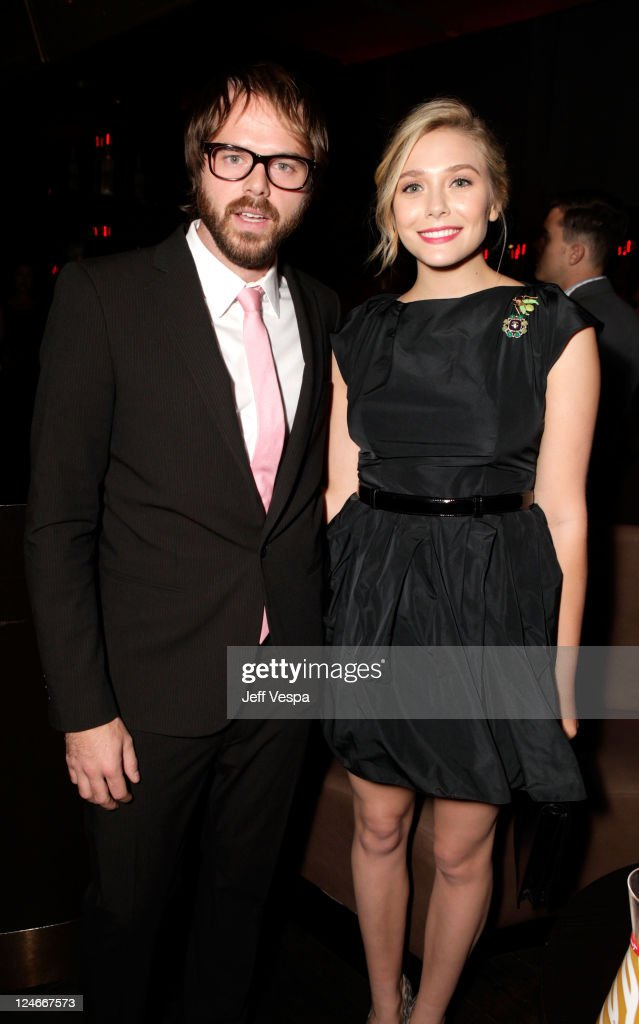 Director Sean Durkin (L) and actress <a gi-track='captionPersonalityLinkClicked' href=/galleries/search?phrase=Elizabeth+Olsen&family=editorial&specificpeople=5775031 ng-click='$event.stopPropagation()'>Elizabeth Olsen</a> attend the Fox Searchlight Pictures, Belvedere Vodka And Vanity Fair Celebration of 'Martha Marcy May Marlene' And 'The Descendants' at the 2011 Toronto International Film Festival at the Thompson Hotel on September 10, 2011 in Toronto, Canada.