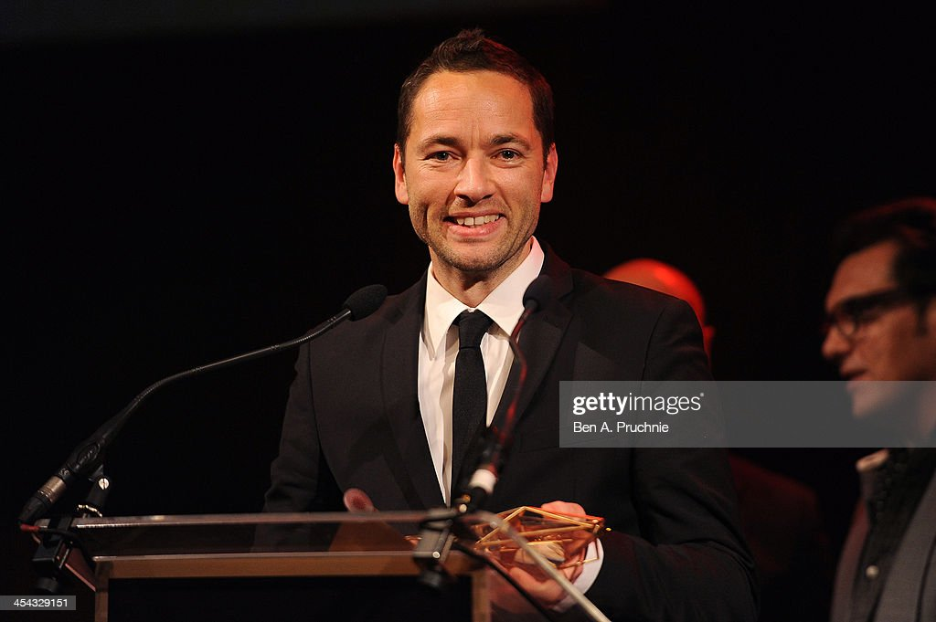 Director Sean Ellis receives the Best Achievement in Production award for 'Metro Manila' as he attends the ceremony for the Moet British Independent Film Awards at Old Billingsgate Market on December 8, 2013 in London, England.