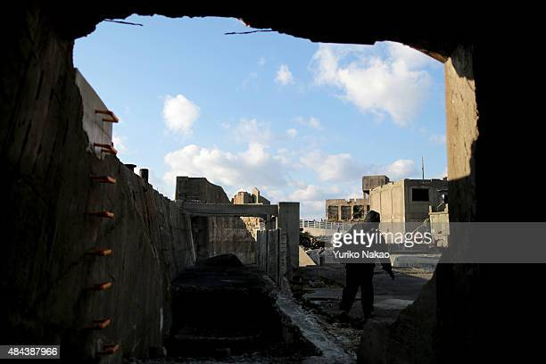 Director Shinji Higuchi is seen through a tunnel during a location hunting for his film 'Attack on Titan' on Hashima Island commonly known as...