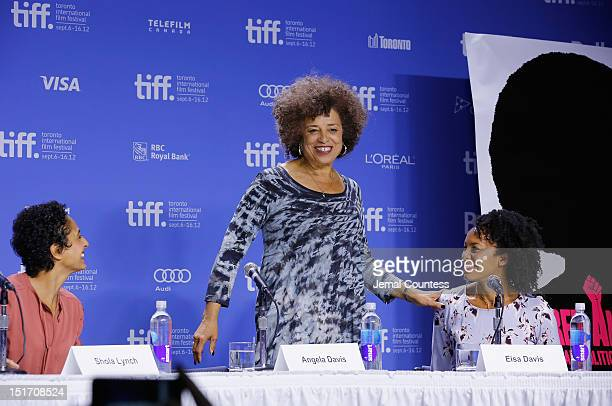 Director Shola Lynch activist Angela Davis and actress Eisa Davis speak onstage at 'Free Angela All Political Prisoners' Press Conference during the...