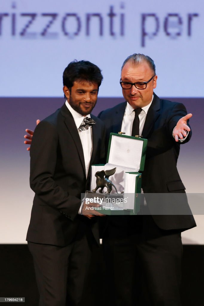 Director Shubhashish Bhutiani (L) receives onstage from Jury Member Frederic Fonteyne (R) the Orizzonti Award for Best Short Film he received for his movie 'Kush' at the Closing Ceremony during the 70th Venice International Film Festival at the Palazzo del Casino on September 7, 2013 in Venice, Italy.