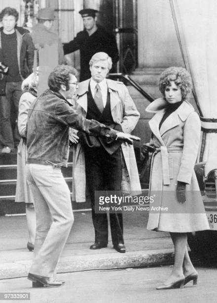 Director Sidney Pollack directs Robert Redford and Barbra Streisand at the Plaza Hotel during filming of 'The Way We Were'