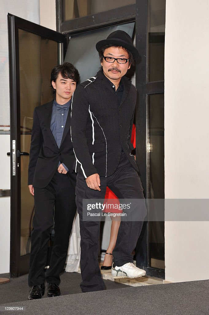 Director Sion Sono and actor Shota Sometani arrive at the 'Himizu' Photocall at the Palazzo del Cinema during the 68th Venice Film Festival on...