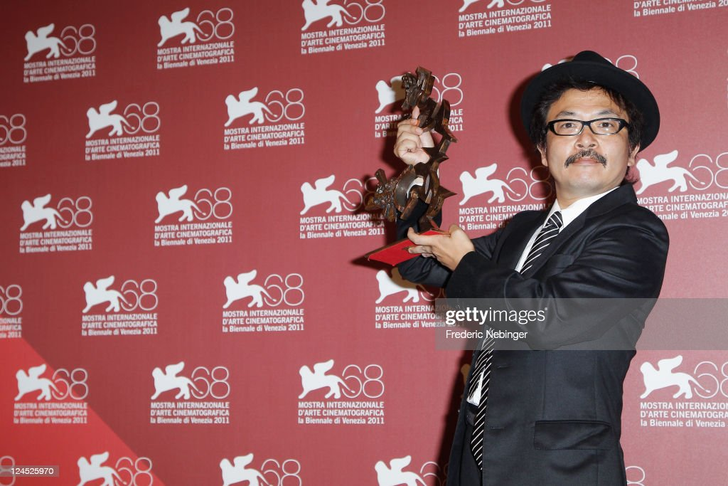 Director Sion Sono of 'Himizu' accepts the Marcello Mastroianni Award for Best Young Actor or Actress on behalf of Shota Sometani and Fumi Nikaido...