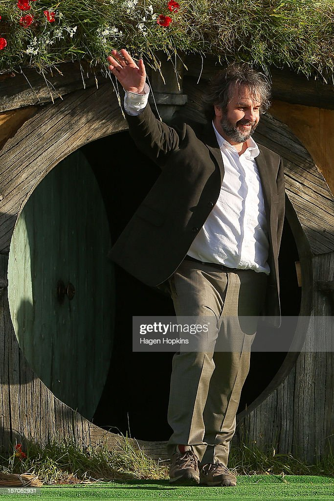Director Sir <a gi-track='captionPersonalityLinkClicked' href=/galleries/search?phrase=Peter+Jackson+-+Filmmaker&family=editorial&specificpeople=203018 ng-click='$event.stopPropagation()'>Peter Jackson</a> emerges from from a Hobbit house before delivering a speech at the 'The Hobbit: An Unexpected Journey' World Premiere at Embassy Theatre on November 28, 2012 in Wellington, New Zealand.