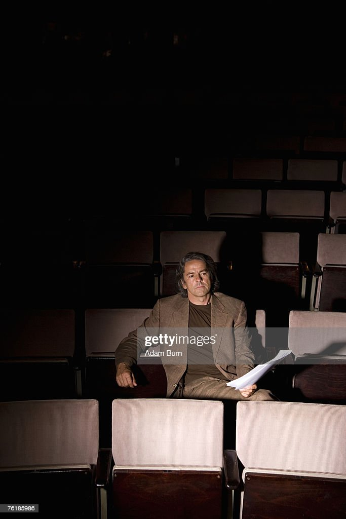 A director sitting in a theater