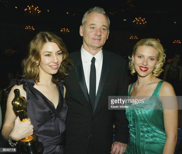 Director Sofia Coppola actor Bill Murray and actress Scarlett Johansson pose at The Governors Ball after the 76th Annual Academy Awards at the...
