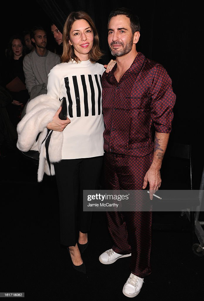 Director Sofia Coppola (L) and designer Marc Jacobs pose backstage at the Marc Jacobs Collection Fall 2013 fashion show during Mercedes-Benz Fashion Week at New York Armory on February 14, 2013 in New York City.
