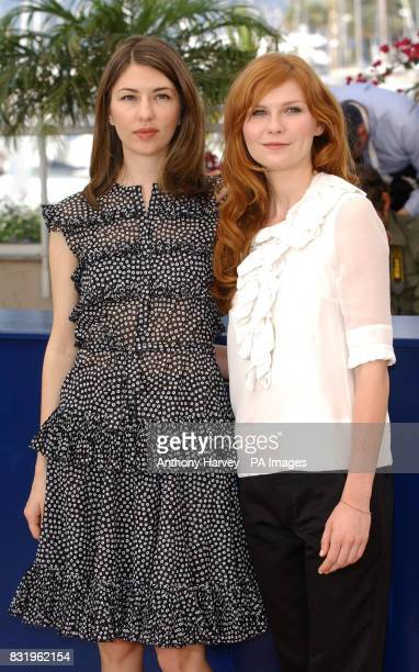Director Sofia Coppola and Kirsten Dunst pose for photographers during the photocall for Marie Antoinette in the Palais des Festival during the 59th...
