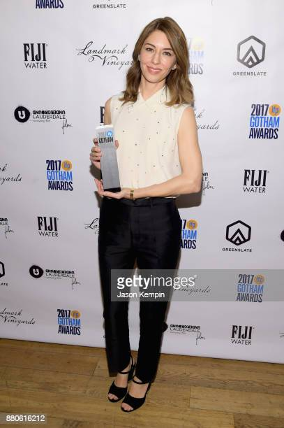 Director Sofia Coppola poses with film tribute award as she attends the GreenSlate Greenroom at The 2017 Gotham Awards at Cipriani Wall Street on...