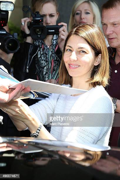 Director Sofia Coppola signs autographs as she is seen arriving in Nice for the 67th Annual Cannes Film Festival on May 13 2014 in Nice France