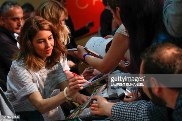TOPSHOT US director Sofia Coppola signs autographs on May 24 2017 after attending a press conference for the film 'The Beguiled' at the 70th edition...