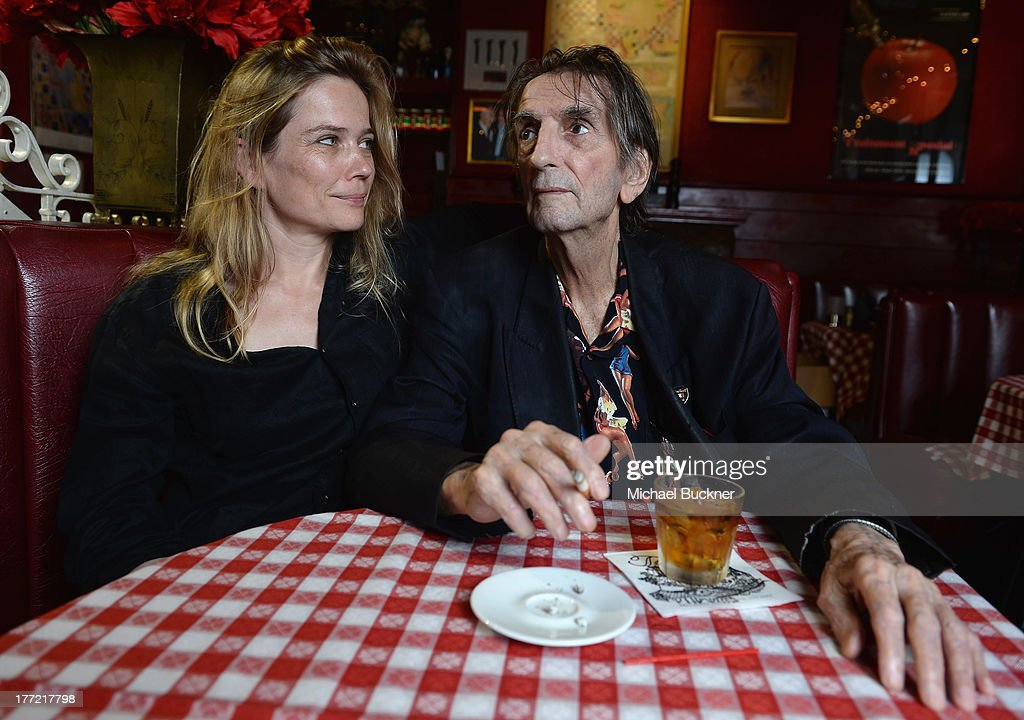 Director Sophie Huber (L) and actor Harry Dean Stanton pose for a portrait for the film 'Harry Dean Stanton: Partly Fiction' at Dan Tana's Restaurant on August 22, 2013 in West Hollywood, California.